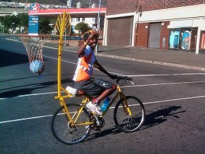 My real biking hero -Lala.  On the same day Lance got paid an appearance fee to ride 109km around Cape Town and fly off in his private jet before the race was over. Lala did it to raise awareness for Hoops 4 Hope on 100 lb mountain bike with a busted seat post and bball hoop attached to the bike.